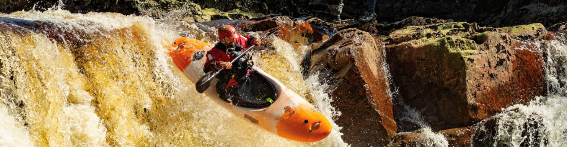 Matt Brooks kayaking down steep water rapids