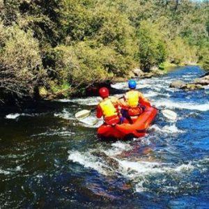 Adventure Plus team white water raft down stream