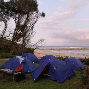 Adventure Plus camp setup by the beach