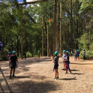 adventurers preparing for high ropes course