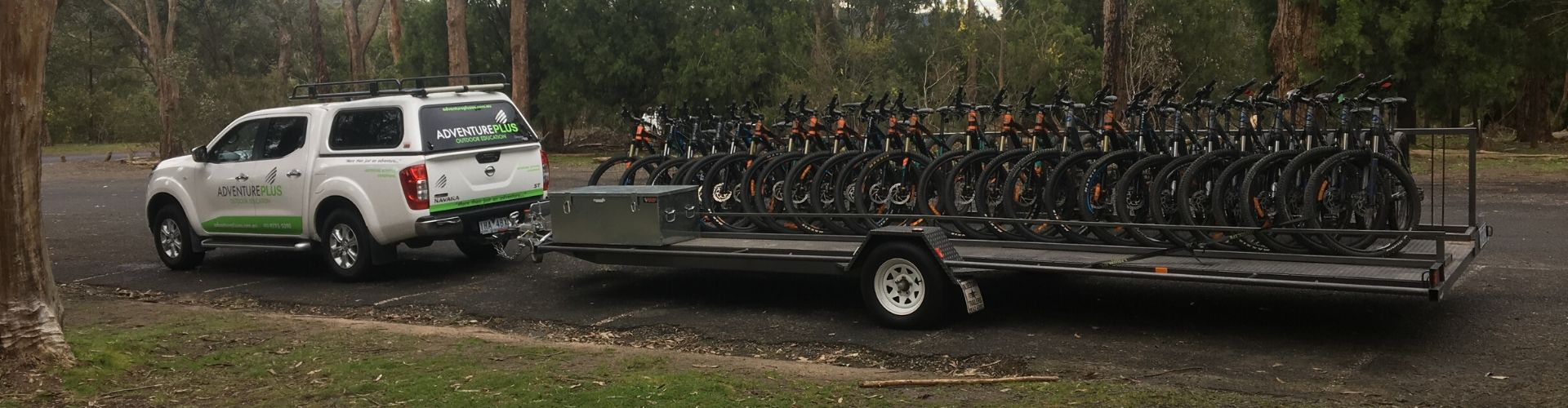 Adventure Plus vehicle with trailer of mountain bikes