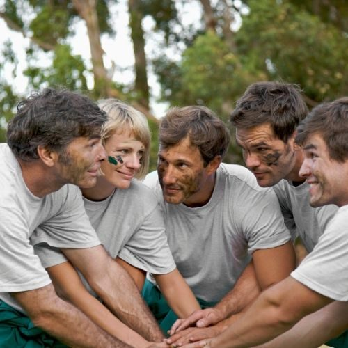 Adventure Plus Corporate Survivor team huddle