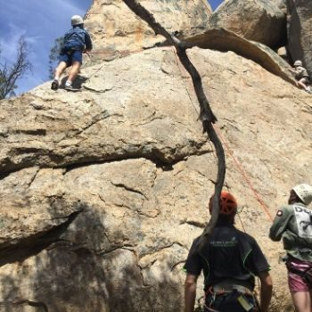 Adventure Plus team rock climbing up steep rocks