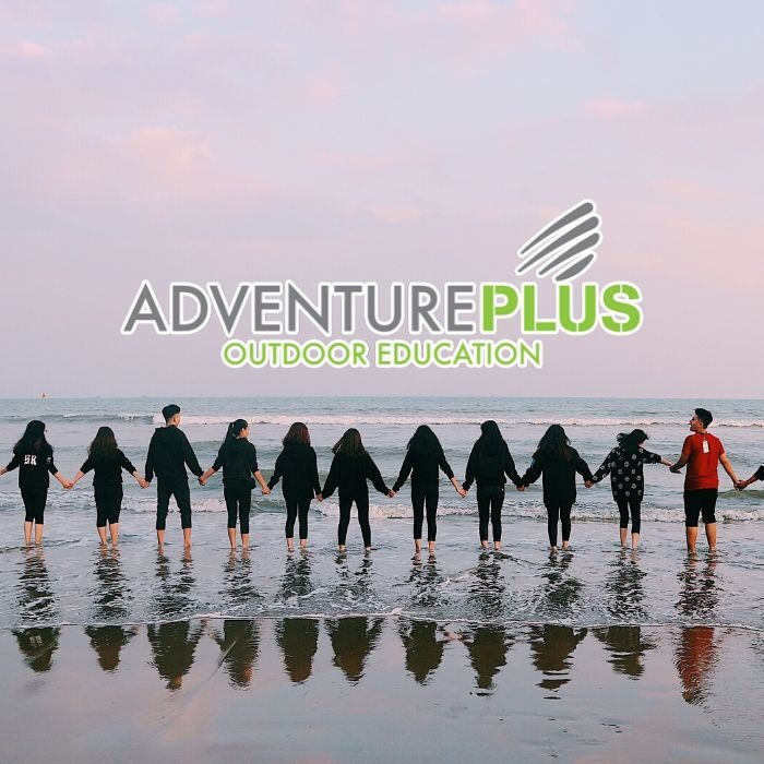Adventure Plus logo with students linking hands